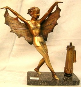 """Rare antique gilted iron match strike on black marble base, featuring the figure of a woman with a cape - with separate lighter (striker insert missing). 11""""H. Circa 1910."""