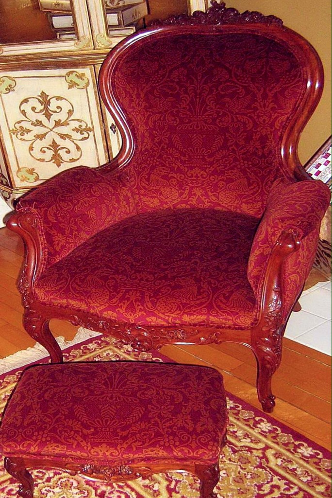 SOLD $950 Lovely hand carved Villarboito armchair and matching stool in gold and burgundy upholstery. Circa 1940.