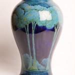 "40. William Moorcroft Pottery vase 'moonlit blue' pattern. Burslem factory. Green painted signature. 14 3/4"" H. Early 20th Century."